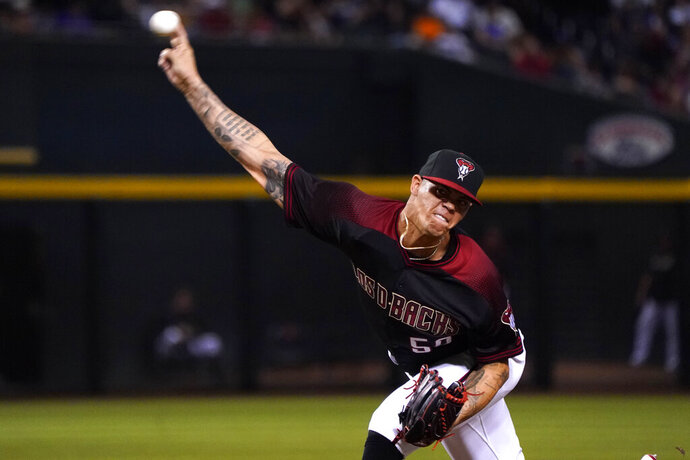 Arizona Diamondbacks relief pitcher Yoan Lopez throws against the Los Angeles Dodgers in the seventh inning during a baseball game Saturday, Aug. 31, 2019, in Phoenix. (AP Photo/Rick Scuteri)