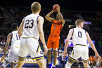Virginia Tech's Landers Nolley II (2) goes up for a shot in front of Notre Dame's Juwan Durham (11), Dane Goodwin (23) and Rex Pflueger (0) during the first half of an NCAA college basketball game Saturday, March 7, 2020, in South Bend, Ind. (AP Photo/Robert Franklin)
