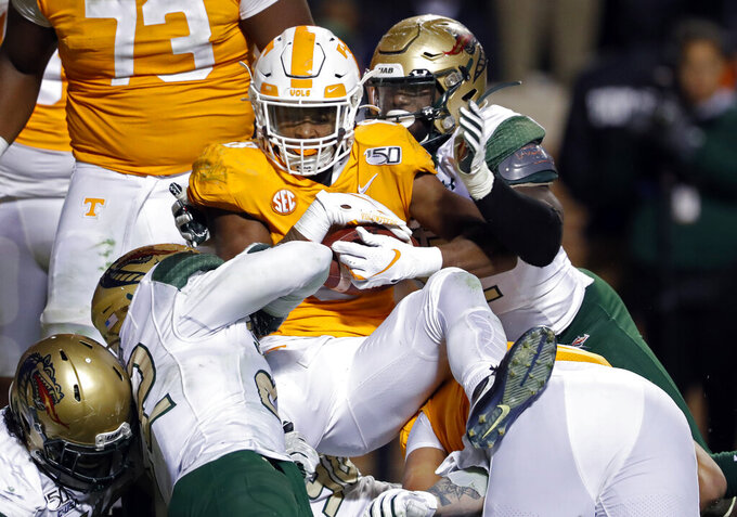 Tennessee running back Ty Chandler (8) is stopped by the against UAB defense in the second half of an NCAA college football game, Saturday, Nov. 2, 2019, in Knoxville, Tenn. (AP Photo/Wade Payne)