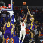 LSU forward Trendon Watford (2) puts a shot up over Florida guard Noah Locke (10) during an NCAA college basketball game, Wednesday, Feb. 26, 2020 in Gainesville, Fla.  (Brad McClenny/The Gainesville Sun via AP)