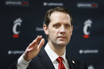 FILE - This April 15, 2019, file photo shows John Brannen speaking during a news conference to formally announce his hiring as Cincinnati's men's basketball coach  in Cincinnati.  Mick Cronin left for UCLA, and Cincinnati turned to a familiar local coach, Brannen, as his replacement. The Bearcats are undergoing significant changes in his first season. (AP Photo/John Minchillo, File)