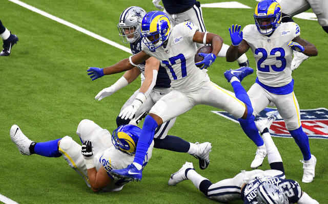 Wide receiver Robert Woods (17) of the Los Angeles Rams leaps for the first down against the Dallas Cowboys in the first half of a NFL football game on opening night at SoFi Stadium in Inglewood on Sunday, September 13, 2020. (Keith Birmingham/The Orange County Register via AP)