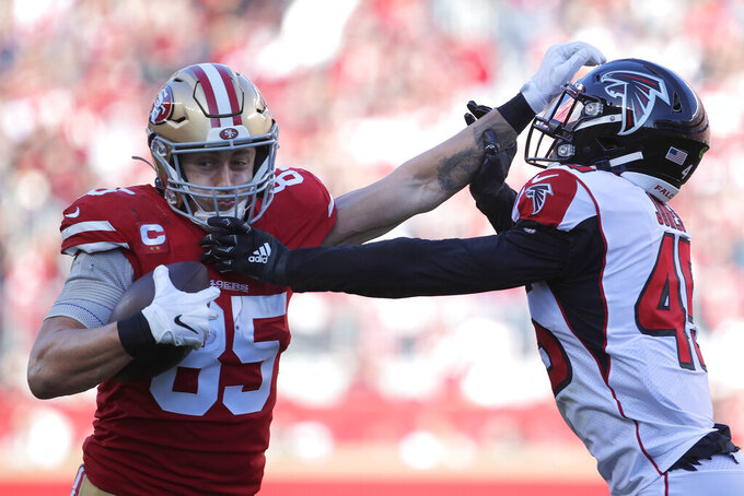 San Francisco 49ers tight end George Kittle (85) stiff arms Atlanta Falcons linebacker Deion Jones during the first half of an NFL football game in Santa Clara, Calif., Sunday, Dec. 15, 2019. (AP Photo/Josie Lepe)