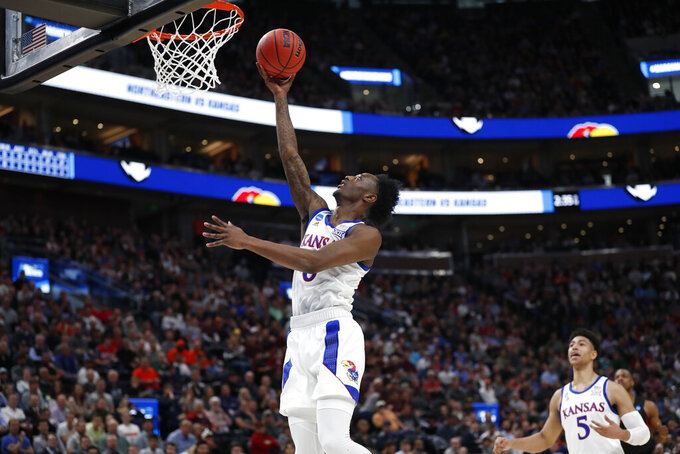 Kansas guard Marcus Garrett (0) shoots against Northeastern in the first half during a first round men's college basketball game in the NCAA Tournament, Thursday, March 21, 2019, in Salt Lake City. (AP Photo/Jeff Swinger)