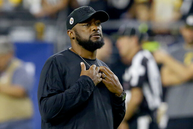 FILE - In this Dec. 8, 2019, file photo, Pittsburgh Steelers head coach Mike Tomlin is shown prior to an NFL football game against the Arizona Cardinals, in Glendale, Ariz. Tomlin says the organization will support most forms of social justice protest by his players, including kneeling during the national anthem. Tomlin says as the organization is on board with any protest as long it is done