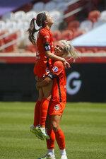 Houston Dash's Rachel Daly, right, lifts Shea Groom (6) after their victory over the Chicago Red Stars in an NWSL Challenge Cup soccer finals match Sunday, July 26, 2020, in Sandy, Utah. (AP Photo/Rick Bowmer)