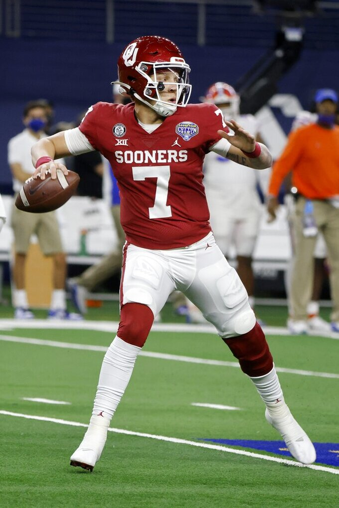 Oklahoma quarterback Spencer Rattler drops back to pass during the second half of the team's Cotton Bowl NCAA college football game against Florida in Arlington, Texas, Wednesday, Dec. 30, 2020. (AP Photo/Michael Ainsworth)