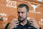 """FILE - In this Aug. 2, 2018, file photo, Texas head coach Tom Herman responds to a question during an NCAA college football news conference, in Austin, Texas. The arrival of a December signing period created plenty of uncertainty in last year's recruiting cycle because nobody knew just how many seniors would go ahead and end their college selection process before the winter holidays. """"I think all of us coaches would tell you it surprised us that so many kids wanted to get it done and signed in December,"""" Texas coach Tom Herman said. (AP Photo/Eric Gay, File)"""