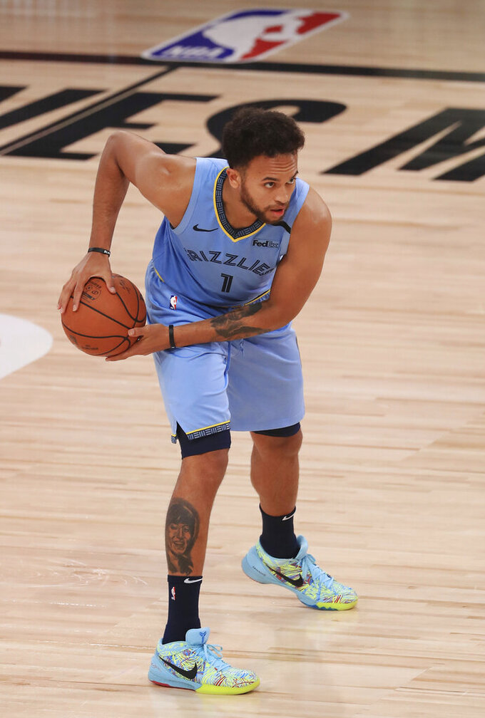 Memphis Grizzlies' Kyle Anderson handles the ball during the second half  of an NBA basketball game against the Portland Trail Blazers, Friday, July 31, 2020, in Lake Buena Vista, Fla. (Mike Ehrmann/Pool Photo via AP)