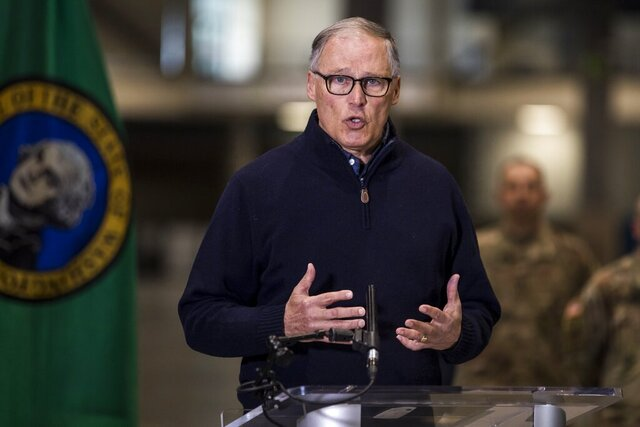 Gov. Jay Inslee discusses the deployment of a field hospital at CenturyLink Field Event Center on Saturday, March 28, 2020, in Seattle, Wash. This field hospital is expected to create at least 150 hospital beds for non-COVID-19 cases. (Amanda Snyder/The Seattle Times via AP, Pool)