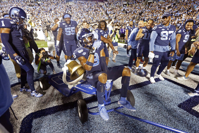 North Carolina wide receiver Antoine Green (3) rides the victory bell following an NCAA college football game against Duke in Chapel Hill, N.C., Saturday, Oct. 26, 2019. (AP Photo/Gerry Broome)
