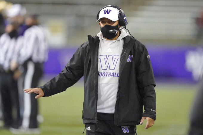 Washington coach Jimmy Lake gestures from the sideline during the first half of the team's NCAA college football game against Oregon State, Saturday, Nov. 14, 2020, in Seattle. (AP Photo/Ted S. Warren)