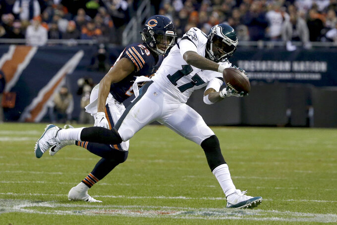 Philadelphia Eagles wide receiver Alshon Jeffery (17) makes a catch under pressure from Chicago Bears cornerback Kyle Fuller (23) during the first half of an NFL wild-card playoff football game Sunday, Jan. 6, 2019, in Chicago. (AP Photo/David Banks)