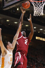 Arkansas forward Adrio Bailey (2) attempts a shot over Tennessee forward John Fulkerson (10) in the first half of an NCAA college basketball game, Tuesday, Jan. 15, 2019, in Knoxville, Tenn. (AP Photo/Shawn Millsaps)