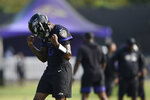 Baltimore Ravens quarterback Lamar Jackson reacts after a complete pass during an NFL football practice, Monday, Aug. 9, 2021 in Owings Mills, Md.(AP Photo/Gail Burton)