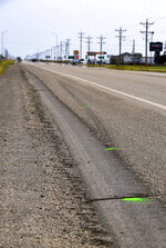 Green spray paint marks show the path of tire skid marks that leave the roadway at the site of Saturday's fatal crash on Monday, Sept. 14, 2020 outside of Highmore, S.D. For South Dakota Attorney General Jason Ravnsborg spending Saturday driving hundreds of miles on the state's roads was not unusual. But by Sunday, it was clear that his latest trip was anything but routine — an investigation was underway that would later reveal he struck and killed a man walking along a rural stretch of highway. (Erin Bormett/The Argus Leader via AP)