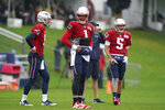 New England Patriots quarterbacks Jake Dolegala, left, Cam Newton (1), and Brian Hoyer (5) stand together during an NFL football practice, Thursday, Aug. 5, 2021, in Foxborough, Mass. (AP Photo/Steven Senne)