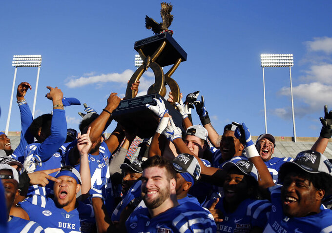 Duke players celebrate their win over Temple in the Independence Bowl NCAA college football game in Shreveport, La., Thursday, Dec. 27, 2018. (AP Photo/Rogelio V. Solis)