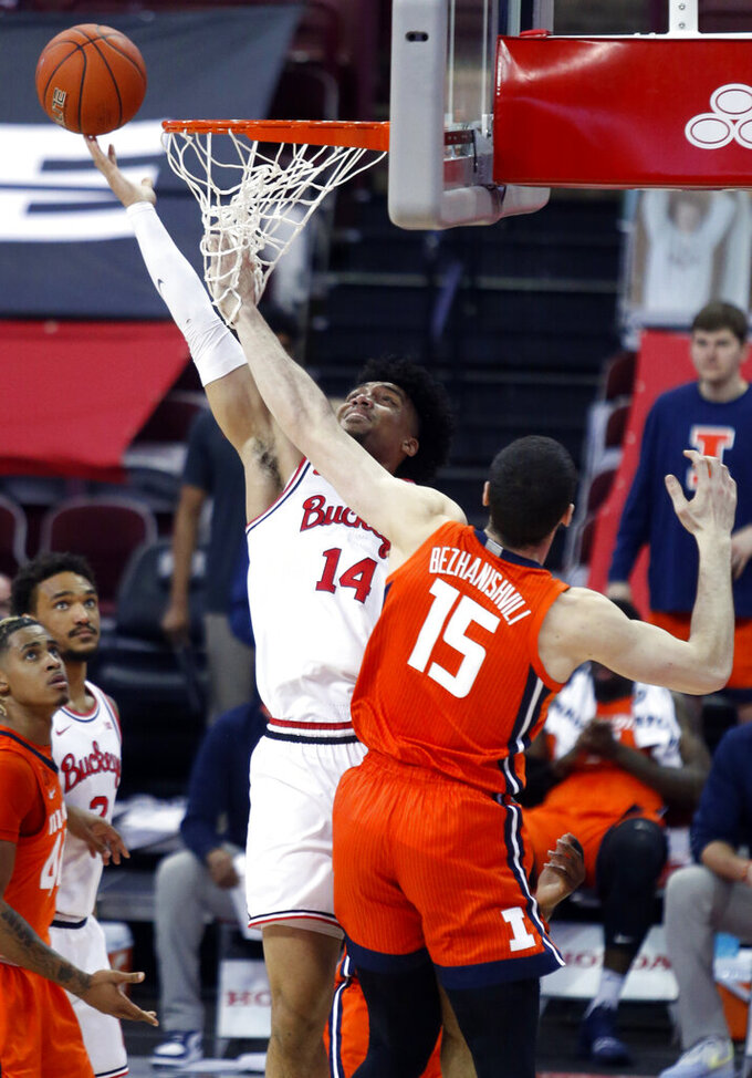 Ohio State forward Justice Sueing, left, goes up to shoot against Illinois forward Giorgi Bezhanishvili during the first half of an NCAA college basketball game in Columbus, Ohio, Saturday, March 6, 2021. (AP Photo/Paul Vernon)