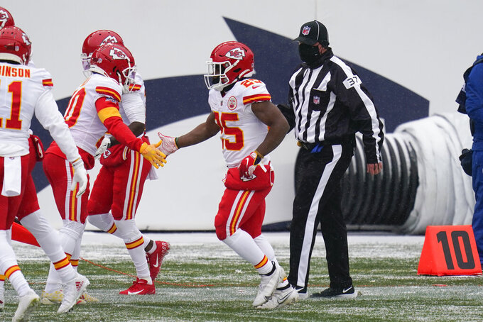 Kansas City Chiefs running back Clyde Edwards-Helaire is greeted by teammates after scoring a touchdown during the first half of an NFL football game against the Denver Broncos, Sunday, Oct. 25, 2020, in Denver. (AP Photo/Jack Dempsey)