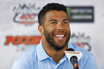 Bubba Wallace smiles during a NASCAR news conference at Pocono Raceway, Friday, May 31, 2019, in Long Pond, Pa. (AP Photo/Matt Slocum)