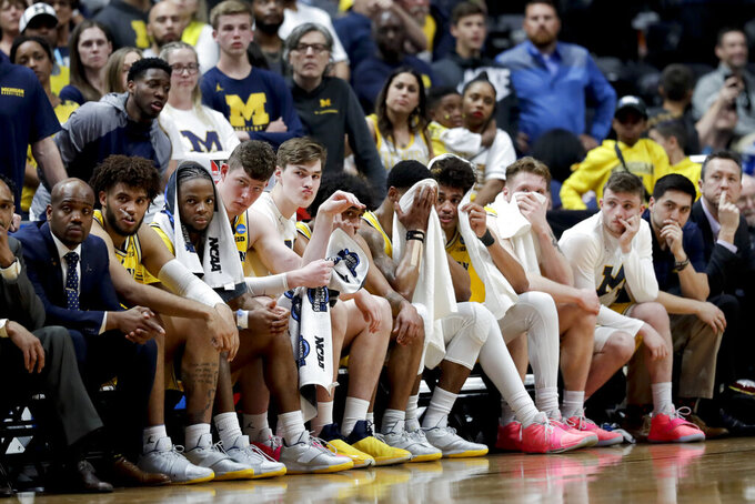 Michigan players sits on the bench during their loss to Texas Tech during an NCAA men's college basketball tournament West Region semifinal Thursday, March 28, 2019, in Anaheim, Calif. (AP Photo/Marcio Jose Sanchez)