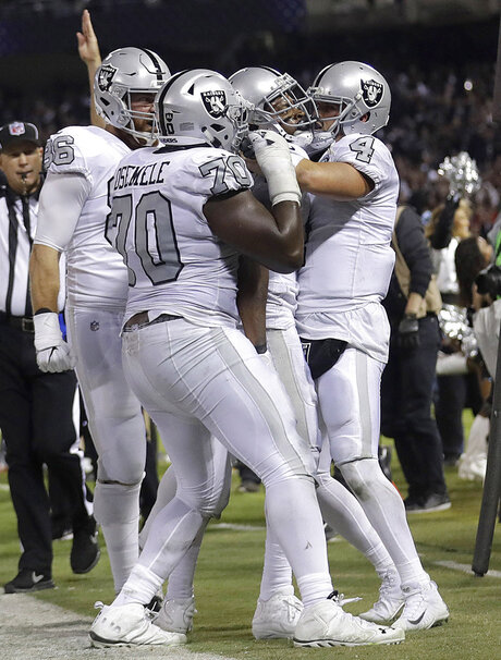 Derek Carr, Kelechi Osemele, Michael Crabtree, Lee Smith