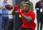 Former Mississippi wide receiver AJ Brown catches a pass while running patterns as he is tested by NFL scouts and coaches during Pro Day at Mississippi, Friday, March 29, 2019, in Oxford, Miss. (AP Photo/Rogelio V. Solis)
