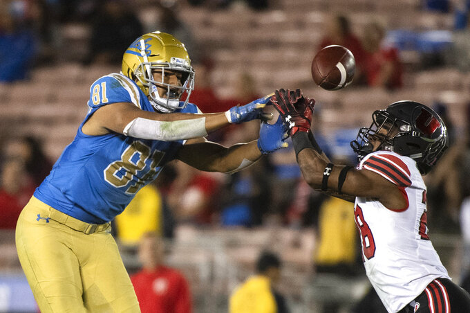 UCLA tight end Caleb Wilson, left, can't catch a pass over Utah defensive back Javelin K. Guidry during the second half of an NCAA college football game Friday, Oct. 26, 2018, in Pasadena, Calif. (AP Photo/Kyusung Gong)