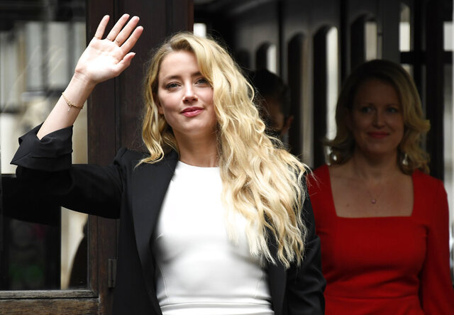 Amber Heard arrives at High Court, in London, Monday, July 27, 2020. Hollywood actor Johnny Depp is suing News Group Newspapers over a story about his former wife Amber Heard, published in The Sun in 2018 which branded him a 'wife beater', a claim he denies.(AP Photo/Alberto Pezzali)