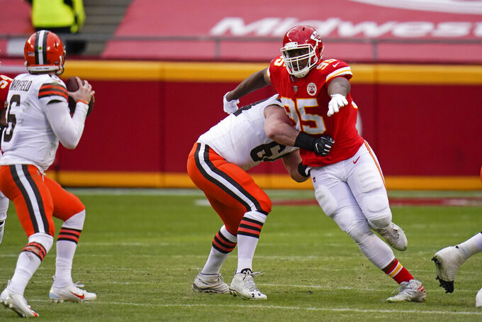 Kansas City Chiefs defensive tackle Chris Jones (95) rushes Cleveland Browns quarterback Baker Mayfield, left, during the second half of an NFL divisional round football game, Sunday, Jan. 17, 2021, in Kansas City. (AP Photo/Jeff Roberson)