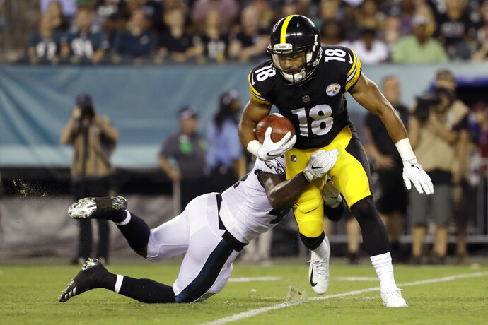 Pittsburgh Steelers' Justin Thomas (18) is tackled by Philadelphia Eagles' Jeremy Reaves (41) during the second half of a preseason NFL football game Thursday, Aug. 9, 2018, in Philadelphia. (AP Photo/Matt Rourke)
