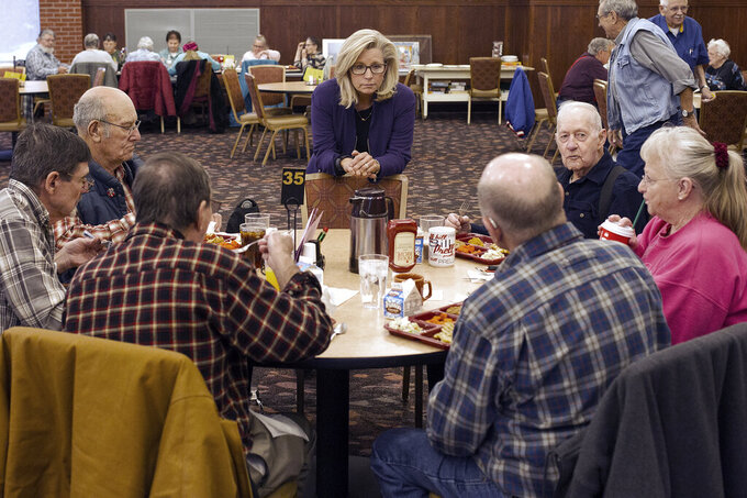 FILE - In this Feb. 1, 2016, file photo, Liz Cheney, center, talks to people at the Senior Citizens Center in Gillette, Wyo., after earlier in the day announcing she would run fro Congress. Removing congresswoman Liz Cheney from House GOP leadership was a relatively easy task for pro-Trump Republicans compared to their growing effort to boot her from office. (Ed Glazar/Gillette News Record via AP)