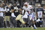 Central Florida wide receiver Tre Nixon (16) catches a pass in front of SMU cornerback Robert Hayes Jr. (7) for a 37-yard gain during the first half of an NCAA college football game Saturday, Oct. 6, 2018, in Orlando, Fla. (AP Photo/Phelan M. Ebenhack)