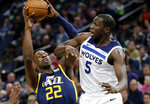Utah Jazz center Jeff Green (22) drives on Minnesota Timberwolves center Gorgui Dieng (5) during the first quarter of an NBA basketball game Wednesday, Nov. 20, 2019 in Minneapolis. (AP Photo/Andy Clayton-King)
