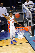 Florida guard Noah Locke (10) shoots a 3-point basket during the first half of a college basketball game against Oral Roberts in the second round of the NCAA tournament at Indiana Farmers Coliseum, Sunday, March 21, 2021 in Indianapolis. (AP Photo/AJ Mast)