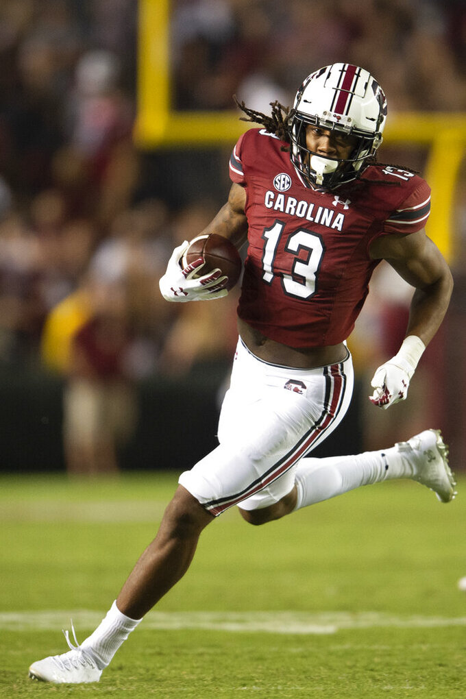 South Carolina wide receiver E.J. Jenkins (13) runs up field during the second half of an NCAA college football game against Kentucky, Saturday, Sept. 25, 2021, at Williams-Brice Stadium in Columbia, S.C. (AP Photo/Hakim Wright Sr.)