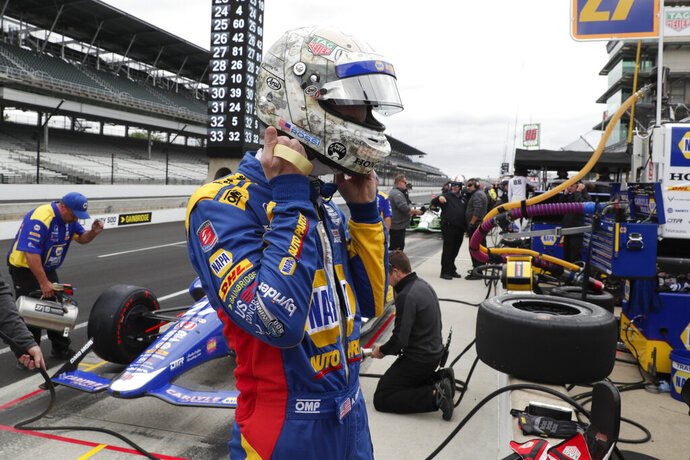 Alexander Rossi prepares to drive before the start of practice for the Indianapolis 500 IndyCar auto race at Indianapolis Motor Speedway, Monday, May 20, 2019, in Indianapolis. (AP Photo/Michael Conroy)