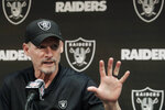 FILE - In this April 11, 2019, file photo, Oakland Raiders general manager Mike Mayock speaks during a news conference at the team's NFL football facility in Alameda, Calif. Star receiver Antonio Brown is not with the Oakland Raiders four days before the season opener amid reports he could be suspended over a confrontation with general manager Mike Mayock. Mayock issued a brief statement at the beginning of practice Thursday, Sept. 5, 2019, saying that Brown wasn't at the Raiders facility and won't be practicing a day after Brown posted a letter from the GM on social media detailing nearly $54,000 in fines.(AP Photo/Jeff Chiu, File)