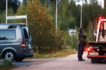Police investigate an incident in an industrial area near Porvoo, Finland, early Sunday Aug. 25, 2019. Police in Finland say two officers have been shot and wounded while on duty in the southern town of Porvoo. Finland's police chief said Sunday the officers were in stable condition. (Roni Rekomaa/Lehtikuva via AP)