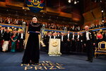 Polish author Olga Tokarczuk, left, receives the Nobel prize from King Carl Gustaf of Sweden, during the Nobel Prize award ceremony at the Stockholm Concert Hall, in Stockholm, Tuesday, Dec. 10, 2019. (Jonas Ekstromer/TT News Agency via AP)