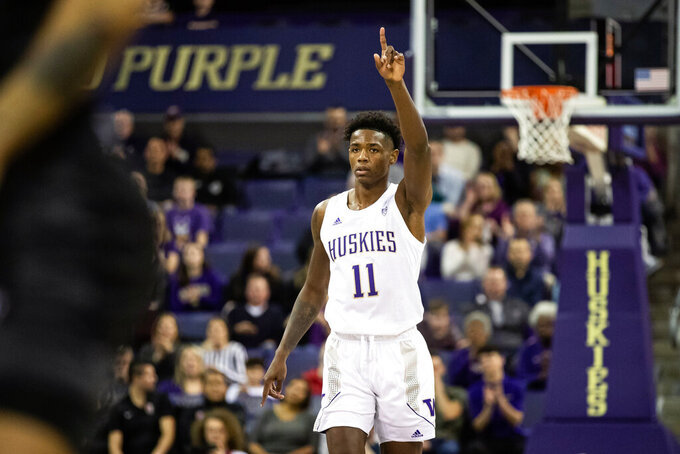 Washington guard Nahziah Carter (11) celebrates his 3-pointer during the first half of an NCAA college basketball game against Seattle, Tuesday, Dec. 17, 2019, in Seattle. (Andy Bao/The Seattle Times via AP)