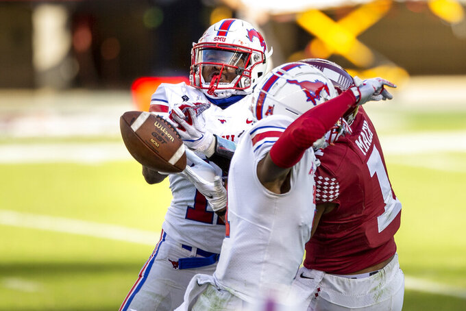 SMU safety Chevin Calloway (11) breaks up a pass intended for Temple wide receiver Branden Mack (1) during the second half of an NCAA college football game, Saturday, Nov. 7, 2020, in Philadelphia. SMU won 47-23. (AP Photo/Laurence Kesterson)