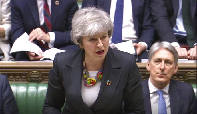 In this image taken from video, Britain's Prime Minister Theresa May gives a statement about progress on Brexit talks to members of parliament in the the House of Commons, London, Tuesday Feb. 12, 2019. Theresa May was urging restive lawmakers Tuesday to