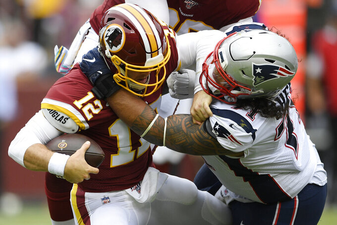 New England Patriots defensive tackle Danny Shelton (71) is sacked by Washington Redskins quarterback Colt McCoy (12) during the first half of an NFL football game, Sunday, Oct. 6, 2019, in Washington. (AP Photo/Nick Wass)