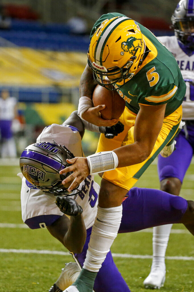 North Dakota State quarterback Trey Lance (5) collides with Central Arkansas defensive back Robert Rochell (9) while making a touchdown in the fourth quarter of an NCAA college football game Saturday, Oct. 3, 2020, in Fargo, N.D. (AP Photo/Bruce Kluckhohn)