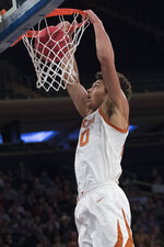 Texas forward Jericho Sims dunks during the first half against Lipscomb in an NCAA college basketball game for the NIT championship Thursday, April 4, 2019, at Madison Square Garden in New York. (AP Photo/Mary Altaffer)