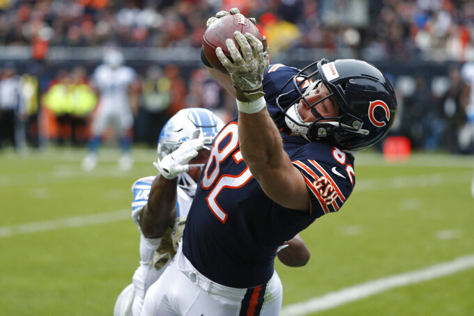 Chicago Bears tight end Ben Braunecker (82) catches an 18-yard touchdown pass as Detroit Lions cornerback Rashaan Melvin (29) defends during the first half of an NFL football game in Chicago, Sunday, Nov. 10, 2019. (AP Photo/Charles Rex Arbogast)