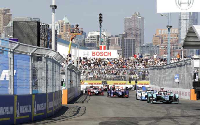 Drivers in the Formula E season finale compete in the auto race in the Brooklyn borough of New York on Saturday, July 13, 2019. (AP Photo/Avery Yang)