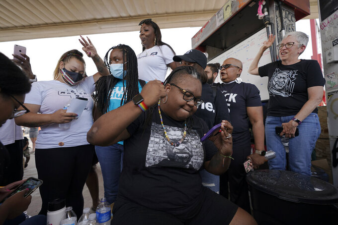 Jennifer Starr Dodd, center, and other supporters react to the sentencing of former Minneapolis police Officer Derek Chauvin for the murder of George Floyd, Friday, June 25, 2021, at George Floyd Square where Floyd was killed, in Minneapolis. Chauvin was sentenced to 22 1/2 years in prison.  (AP Photo/Julio Cortez)